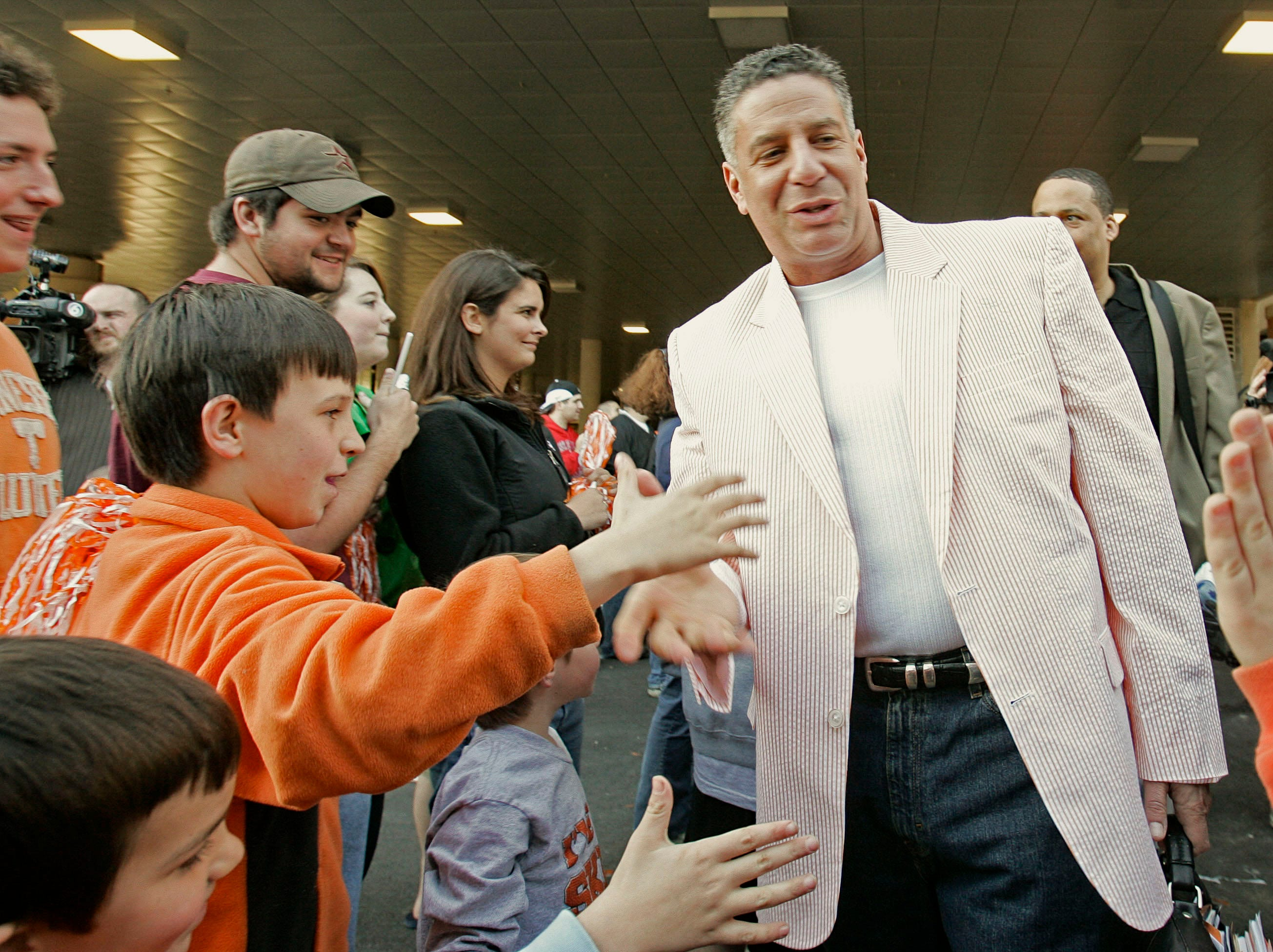 Tennessee coach Bruce Pearl is greeted by fans as the team leaves for Charlotte Tuesday, March 25, 2008 in Knoxville, Tenn. The Vols will play Louisville on Thursday.