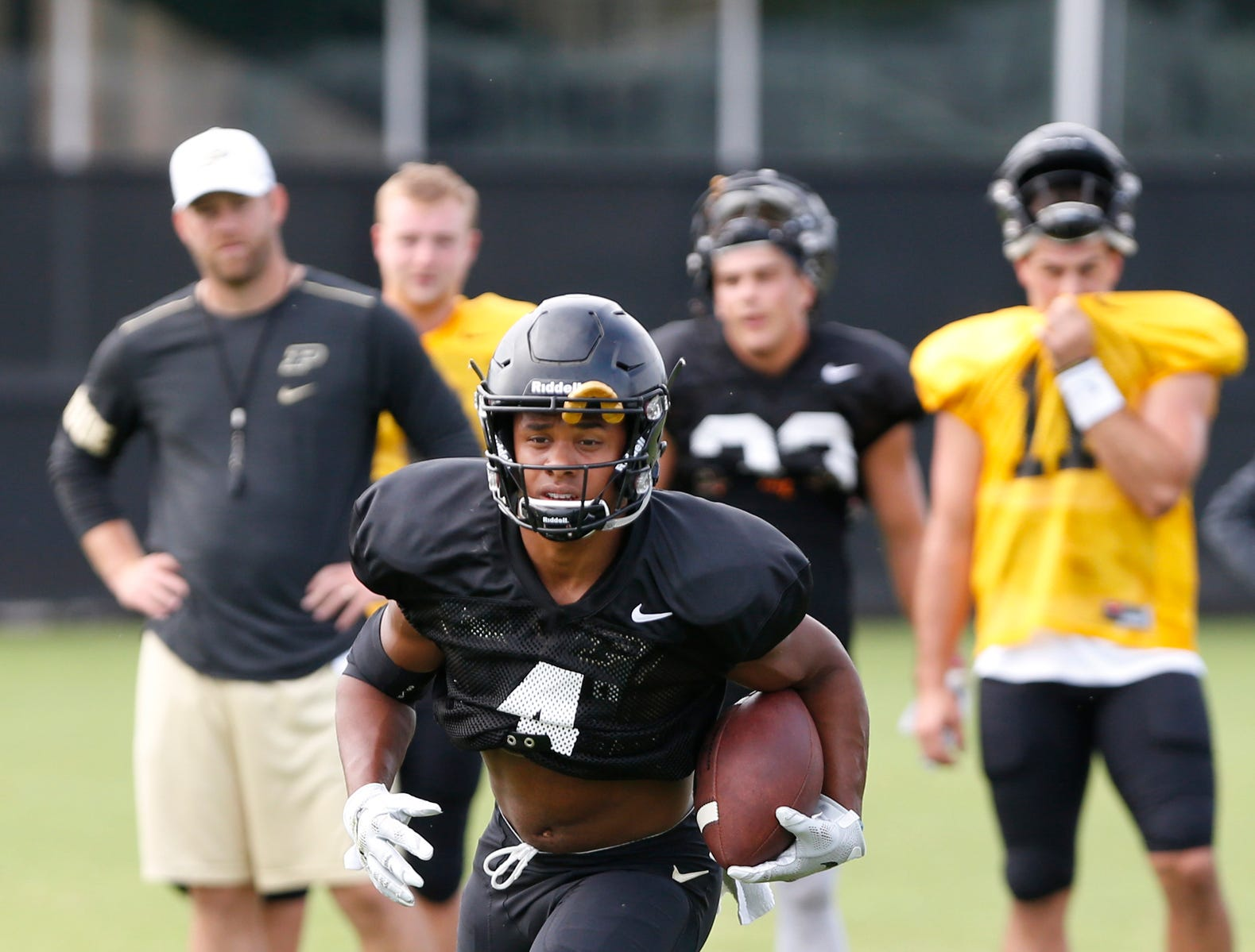 Wide receiver Rondale Moore runs after a pass reception during football practice Tuesday, August 7, 2018, at Purdue.