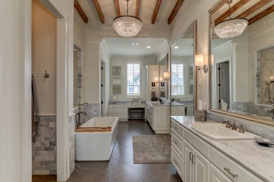 The master bathroom is stunning and serene.