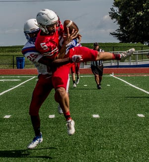 Lakewood's Gabe Servis breaks up a pass intended for Liberty Union's Kobe Barnett during Tuesday's scrimmage.