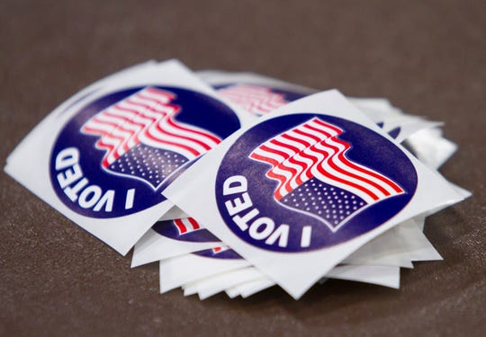 """A stack of """"I voted"""" stickers on the table at a polling location on Aug. 7, 2018."""