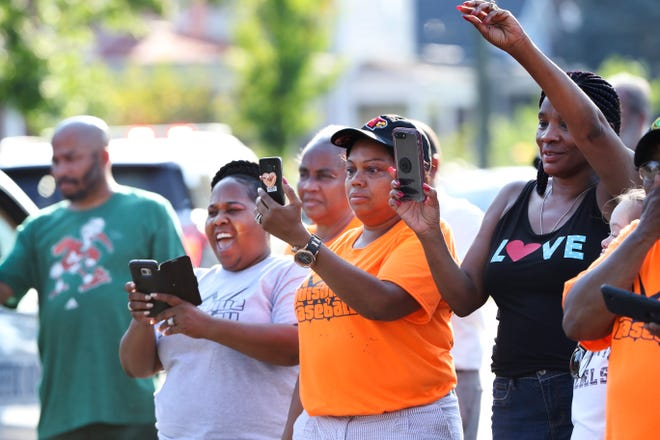 Supporters used smartphones to record the 13 and Under West Louisville All-Stars during a parade along West Broadway to celebrate advancing to the Babe Ruth World Series in Arkansas.Aug. 6, 2018