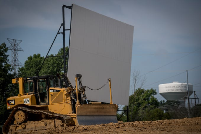 A bulldozer sits near the screen at the Sauerbeck Family Drive-In in LaGrange, Ky, Aug 7, 2018.