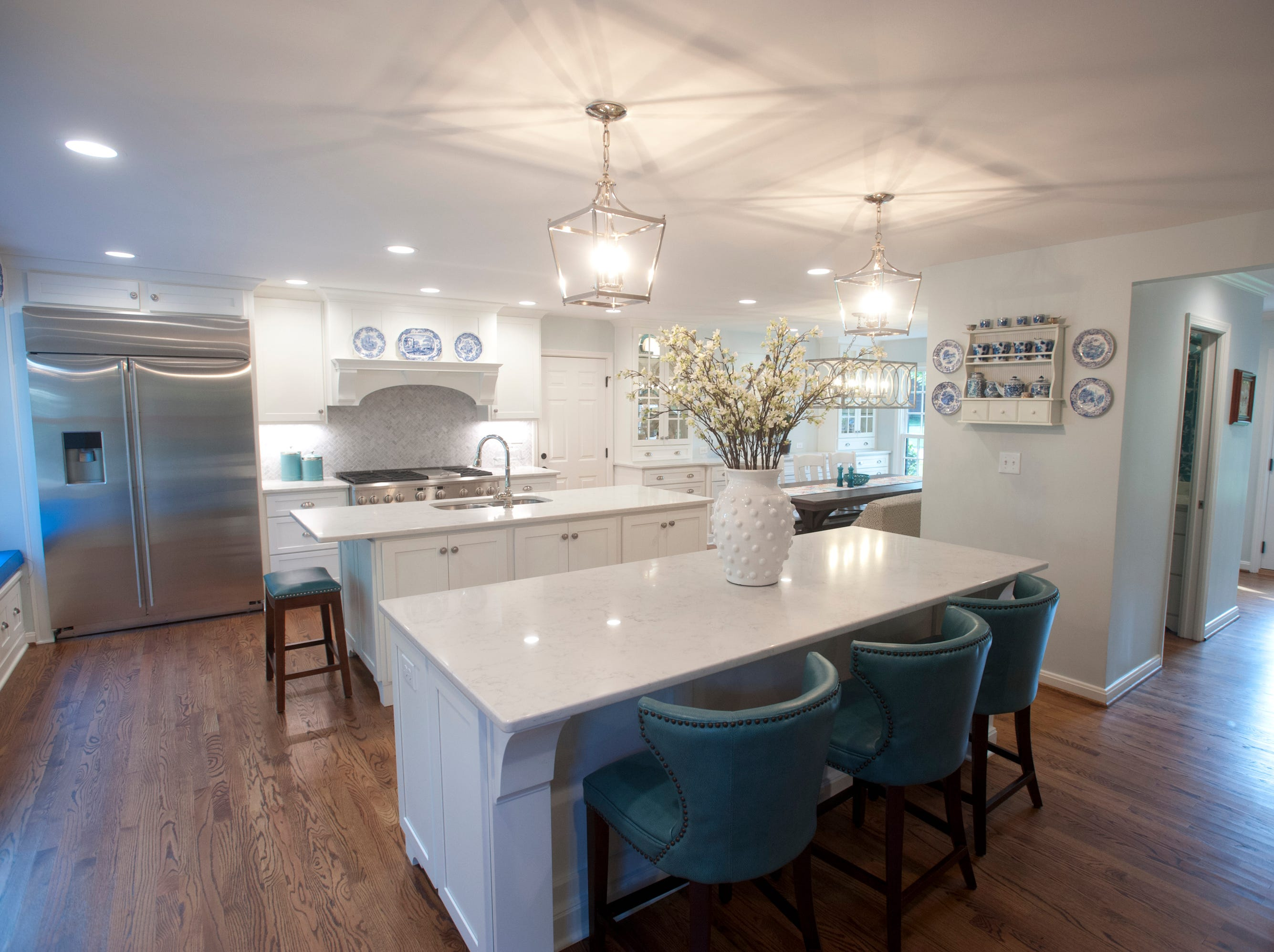 A second island between the kitchen and family room allows more storage and seating.