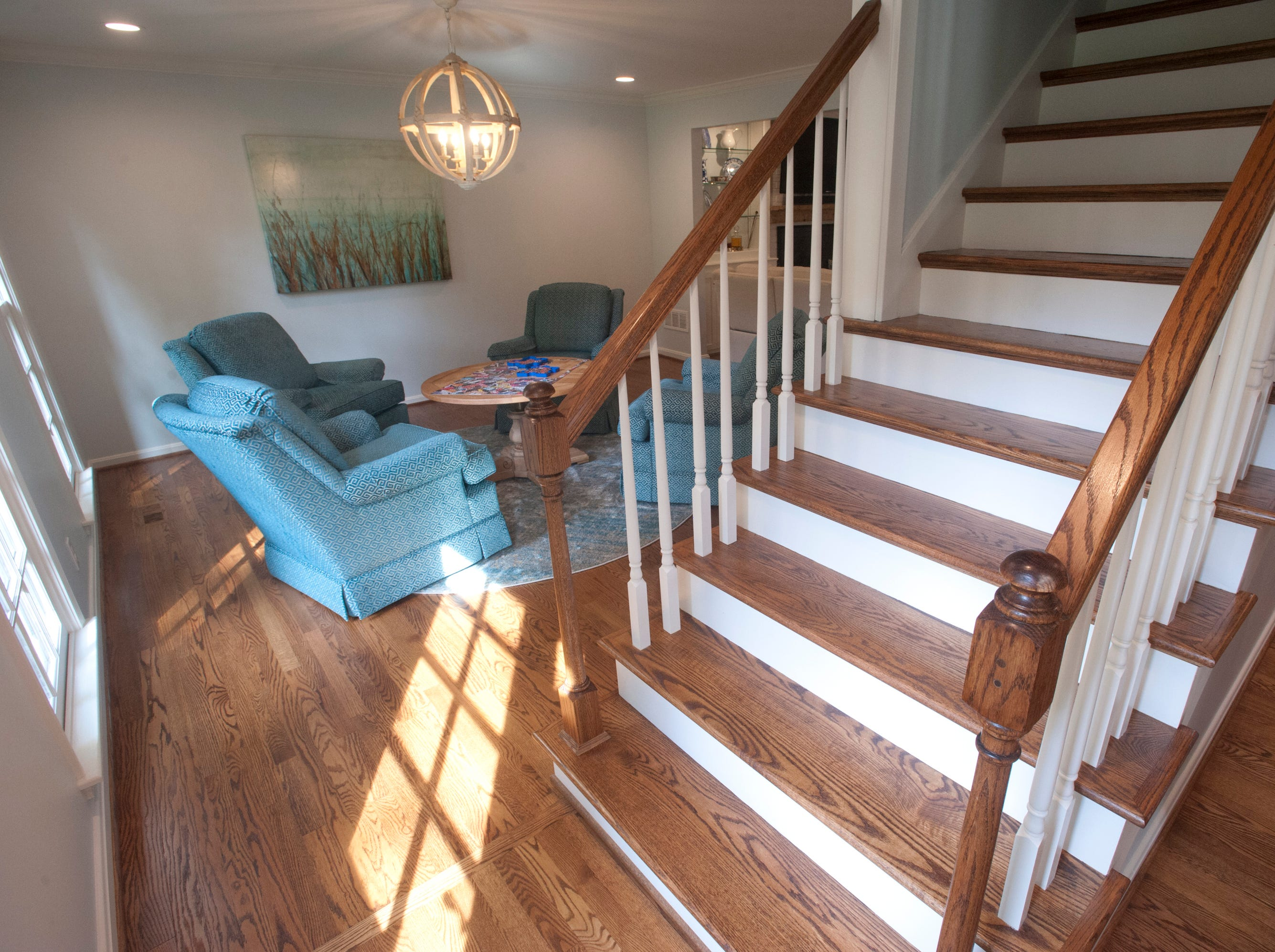 The new open stairway at the home of Jean Hodges which has recently been renovated by Bailey Remodeling, looks into the sitting room which had formerly been the home's living room.