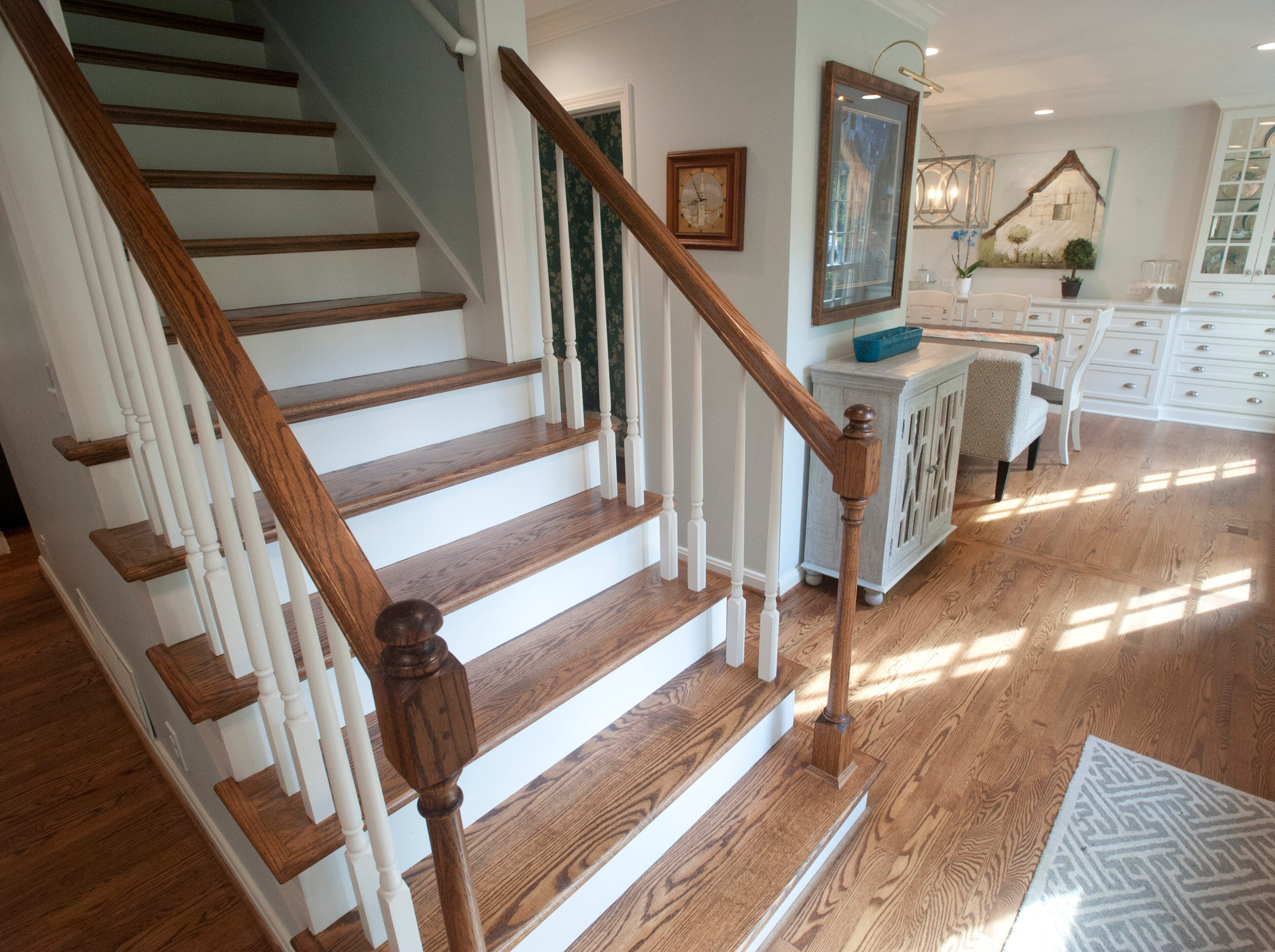 The new open stairway at the home of Jean Hodges which has recently been renovated by Bailey Remodeling, looks into the dining room.