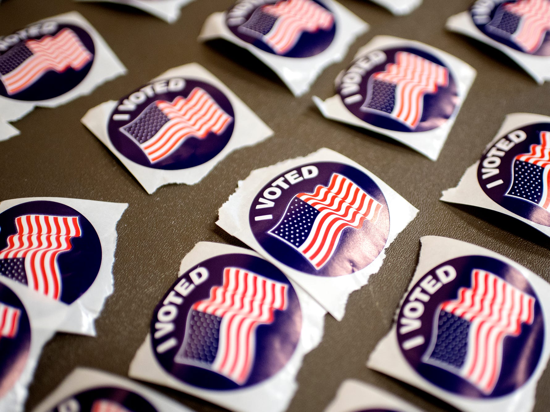 Stickers for voters are displayed on a table at the polling place at Pattengill School on Tuesday, Aug. 7, 2018, in Lansing.