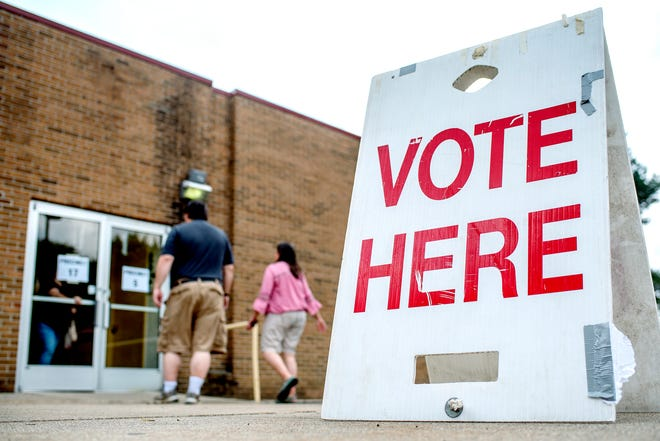 Voters arrive at the polling place at Shaarey Zedek Congregation on Tuesday, Aug. 7, 2018, in East Lansing.