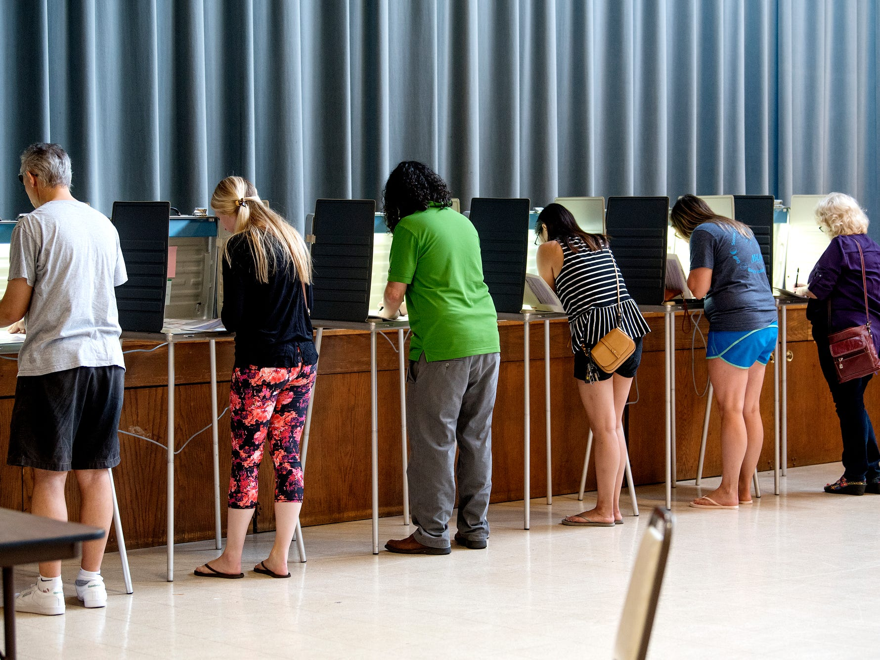 Voters fill out a ballots at the polling place at Shaarey Zedek Congregation on Tuesday, Aug. 7, 2018, in East Lansing.