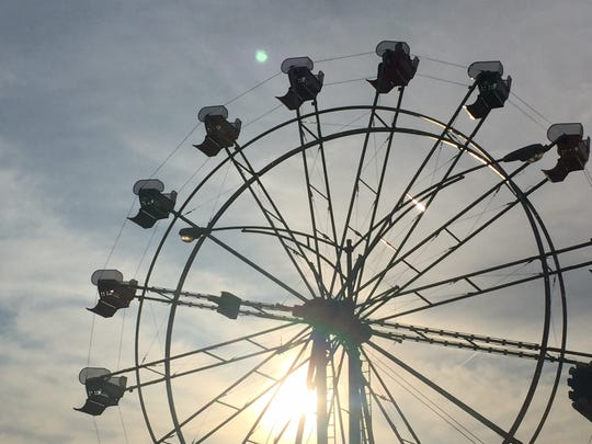 The Ferris wheel spins at the Richland County Fair in 2018. The Richland County commissioners voted unanimously on Tuesday to waive monthly payments through the end of the year on a long-standing loan to the county agricultural society for fairgrounds improvements.