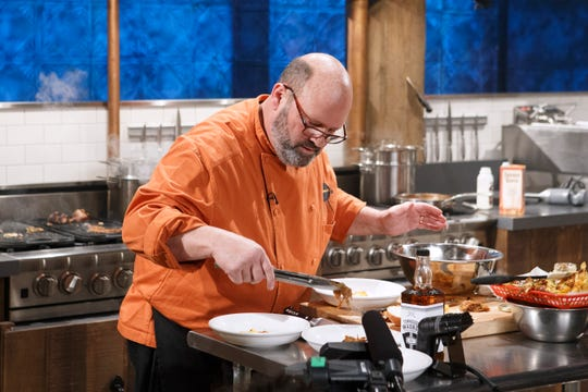 Chef Ernie Mellor of Memphis-based Hog Wild BBQ cooks with pork tenderloin, eggplant, Tennessee whiskey and pulled pork nachos during the appetizer round, as seen on Chopped, Grill Masters Special.