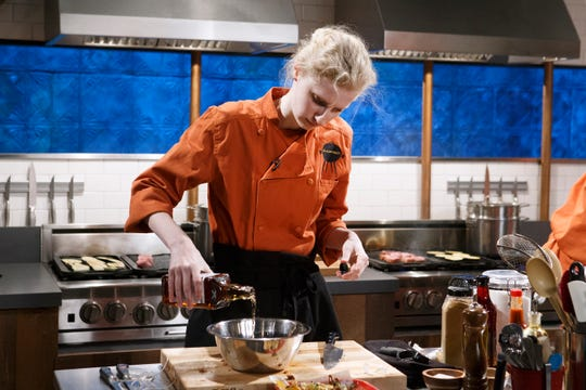 Chef Claire Campbell of Ubons BBQ in Yazoo City, MS cooks with pork tenderloin, eggplant, Tennessee whiskey and pulled pork nachos during the appetizer round, as seen on Chopped, Grill Masters Special.