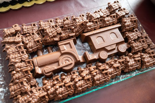 "Dinstuhl's train-shaped chocolates were on the ""Mystery Train"" party menu."