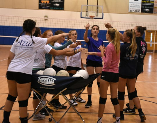 Volleyball coach Alyssa Stolinas, right, leads her team in a practice at MICMS. Marco Island Academy athletics is using a snap-raise.com web page to bring in money to fund their fall sports program.