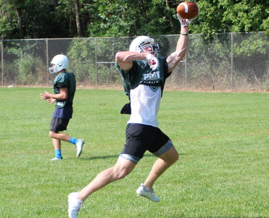 Port Washington wide receiver Jacob Lippe makes a one-handed grab during a pre-season practice.
