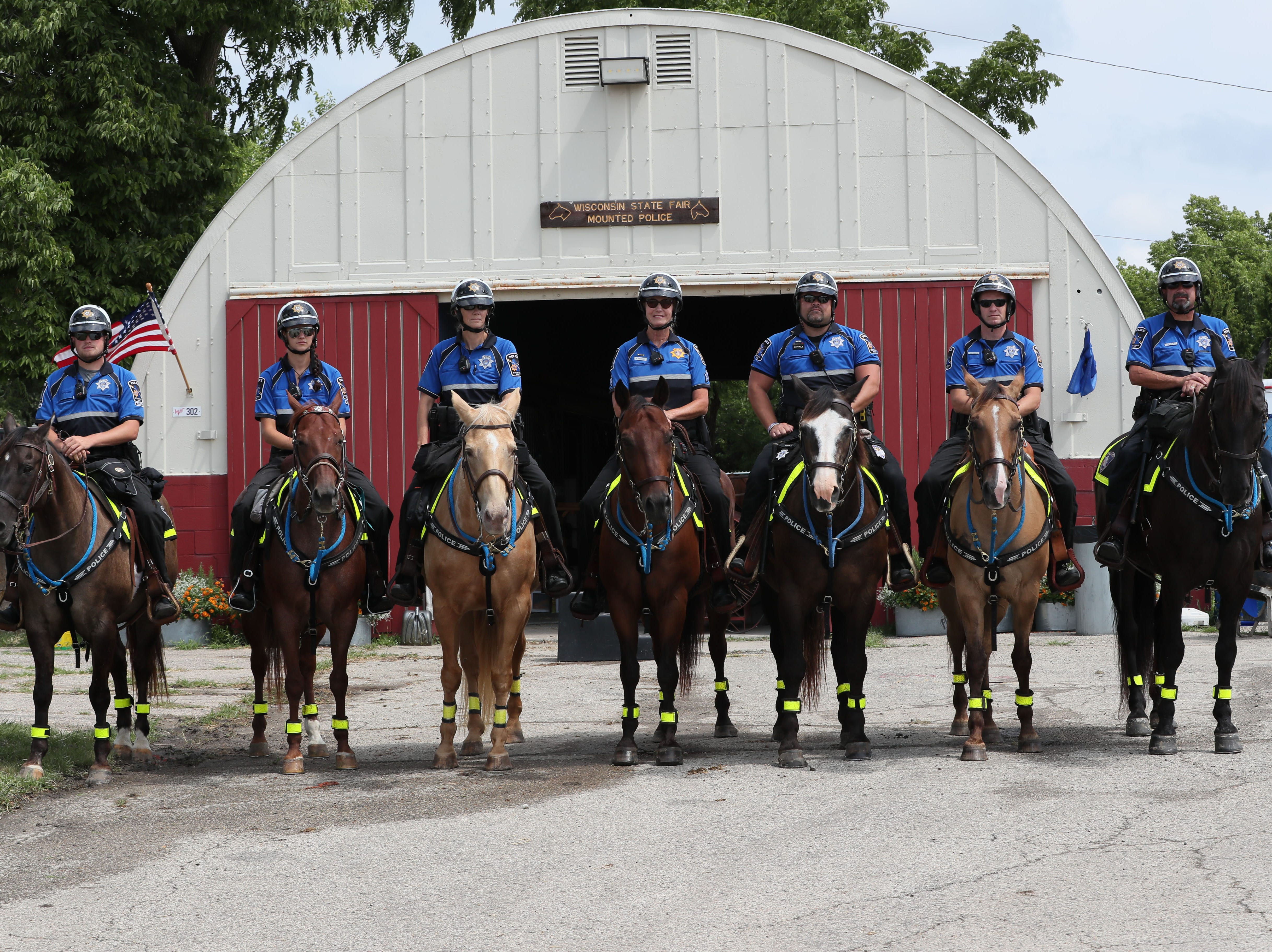 2018 is the 50th anniversary of the Wisconsin State Fair's mounted police patrol.  From left, mounted officers and their horses include Tristan Buddenhagen and Casey, Amanda Lepak and Roxy, Penny Lepak and Rosie, Sergeant Deb Caravello and Saul, Nathan Anhalt and Lil Joe, Kyle Wallschlaeger and Bugsy, and Joe Volz and Montana.