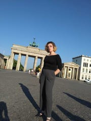 Maria Graziano poses with the Brandenberg Gate in Berlin in the background.