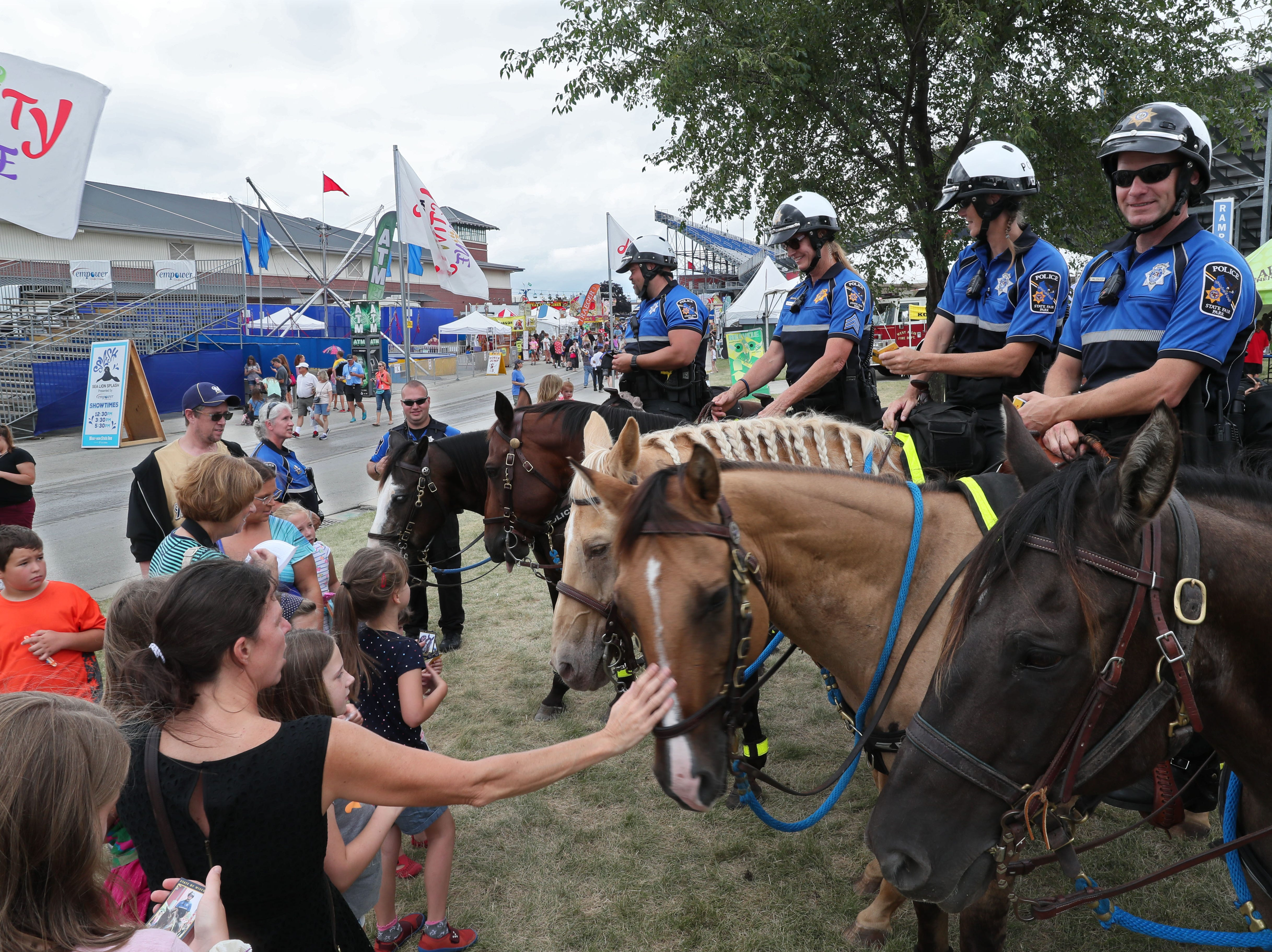 Wisconsin State Fair's mounted police patrol lead the fair's daily parade.  For 50 years the mounted police have both protected guests and served as ambassadors.