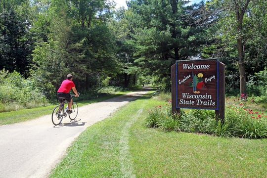 The 14.5-mile Red Cedar State Trail travels south from Menomonie.