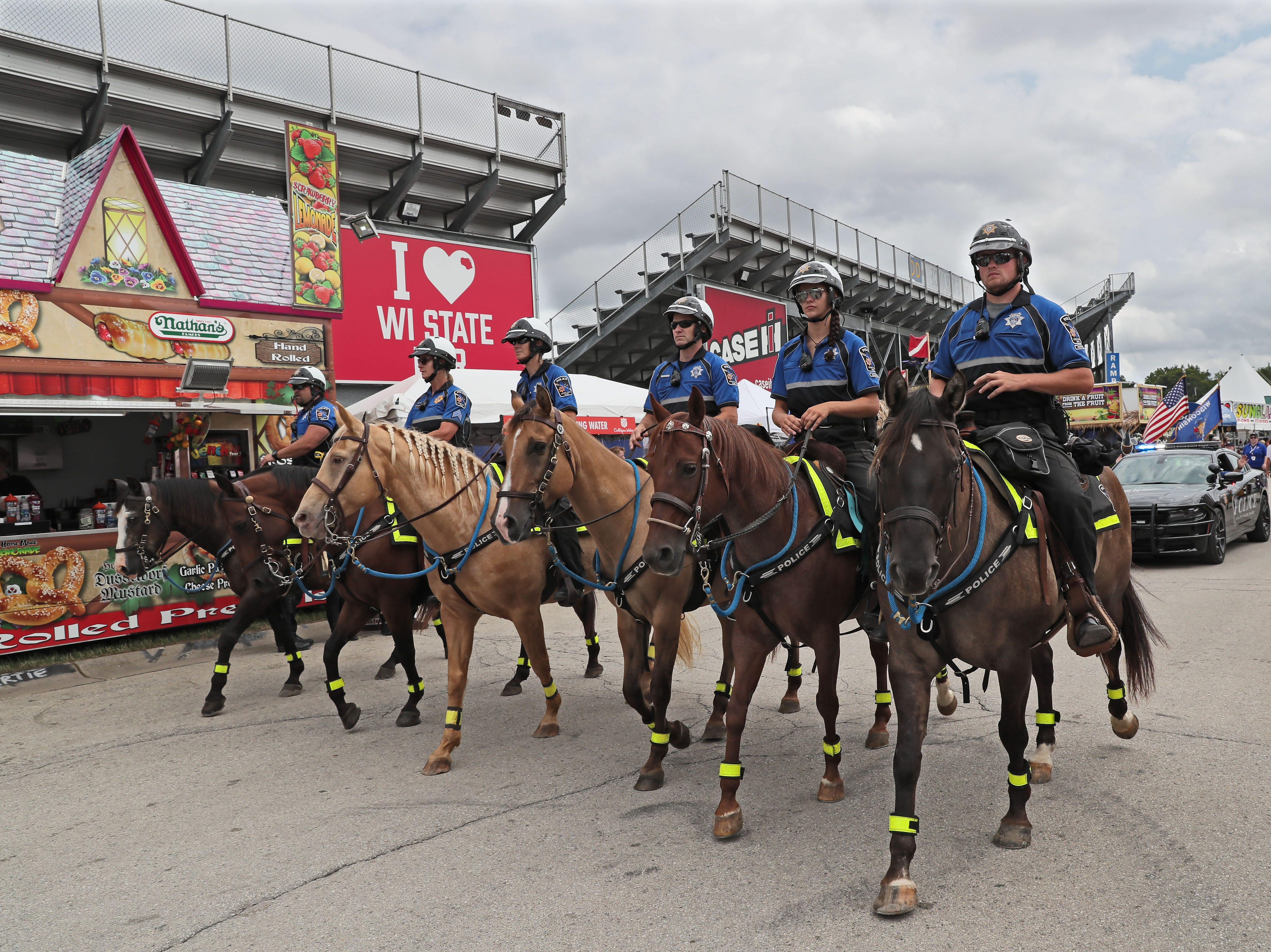 Wisconsin State Fair's mounted police patrol is celebrating its 50th anniversary. In addition to patrolling, the officers lead the fair's daily parade. From left, Nathan Anhalt and horse Lil Joe, Sgt. Deb Caravello and Saul,  Penny Lepak and Rosie, Kyle Wallschlaeger and Bugsy, Amanda Lepak and Roxy,Tristan Buddenhagen and Casey.