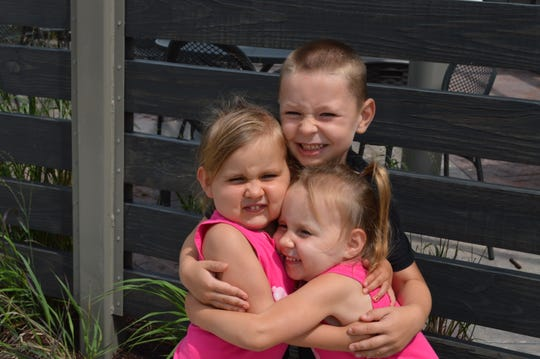 Twins Kendall and Chloe Roehling are 3 years old and their brother Max is 4.