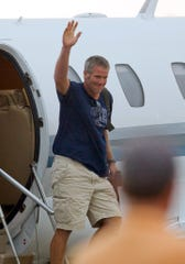 Brett Favre acknowledges fans as he gets off a private jet at Austin Straubel International Airport on Sunday, Aug. 3, 2008, in Green Bay.