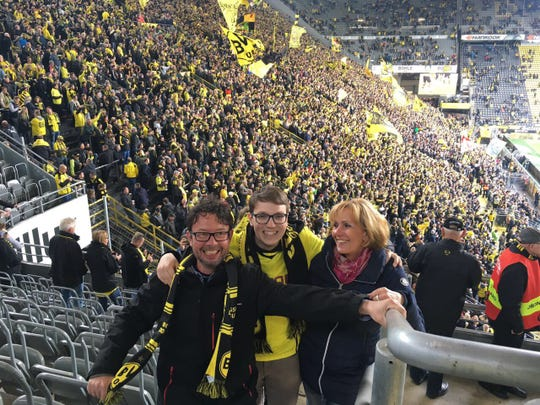 Robert McCracken (middle) takes a picture with his host family at a Borussia Dortmund soccer match. McCracken studied in Munster, located in the northwest part of Germany during his CBYX year.