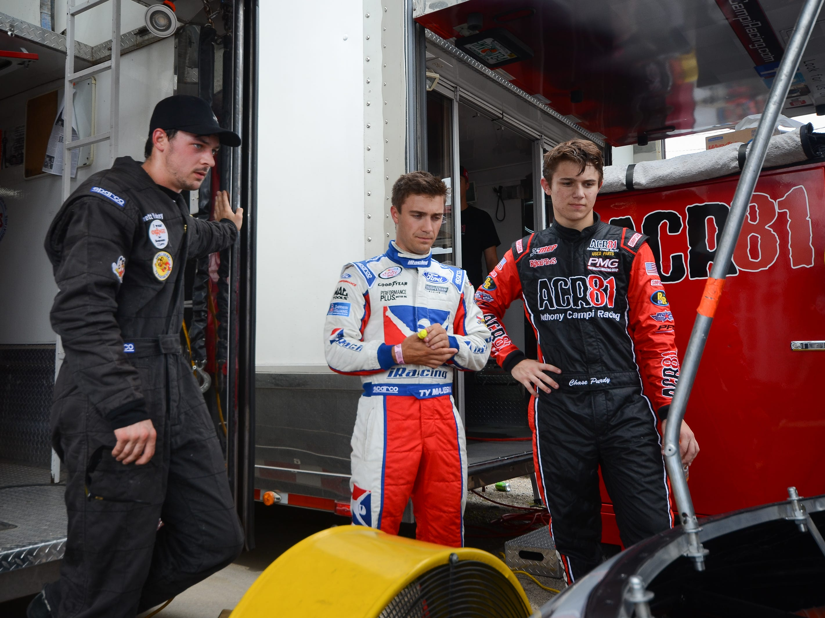 Brett Yackey (from left), Ty Majeski and Chase Purdy talk after the first practice session for the ARCA Midwest Tour Dixieland 250 on Tuesday, August 7, 2018, at Wisconsin International Raceway in Kaukauna, Wis.