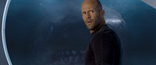 "Jason Statham has company, a giant and ancient shark, in ""The Meg."""