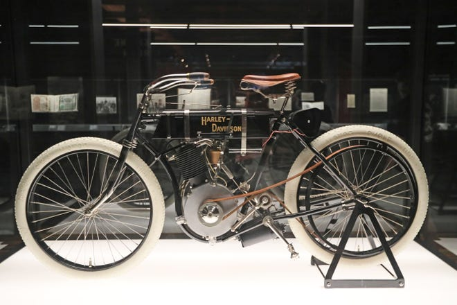 The oldest known Harley-Davidson in existence is displayed in a glass case at the Harley-Davidson Museum.  Its from 1903 and is serial number one.