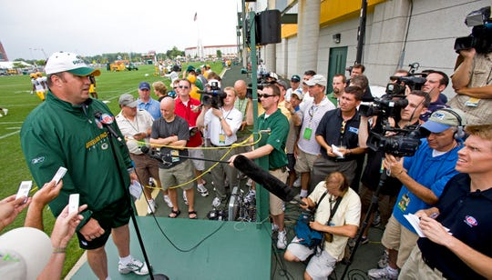 Green Bay Packers head coach Mike McCarthy is surrounded by media asking about Brett Favre who signed and faxed his reinstatement papers today Tuesday July 29, 2008.