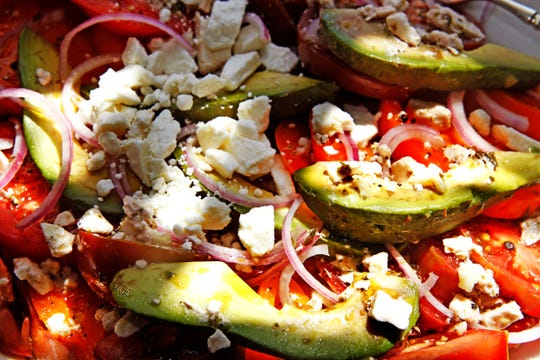 Heirloom tomato salad with feta is a colorful addtion to a salad buffet.