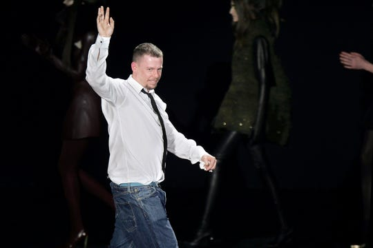 "The life, work and legacy British designer Alexander McQueen, shown in a 2007 photo at a show in Paris, are the focus of Ian Bonhote's new documentary, ""McQueen."""
