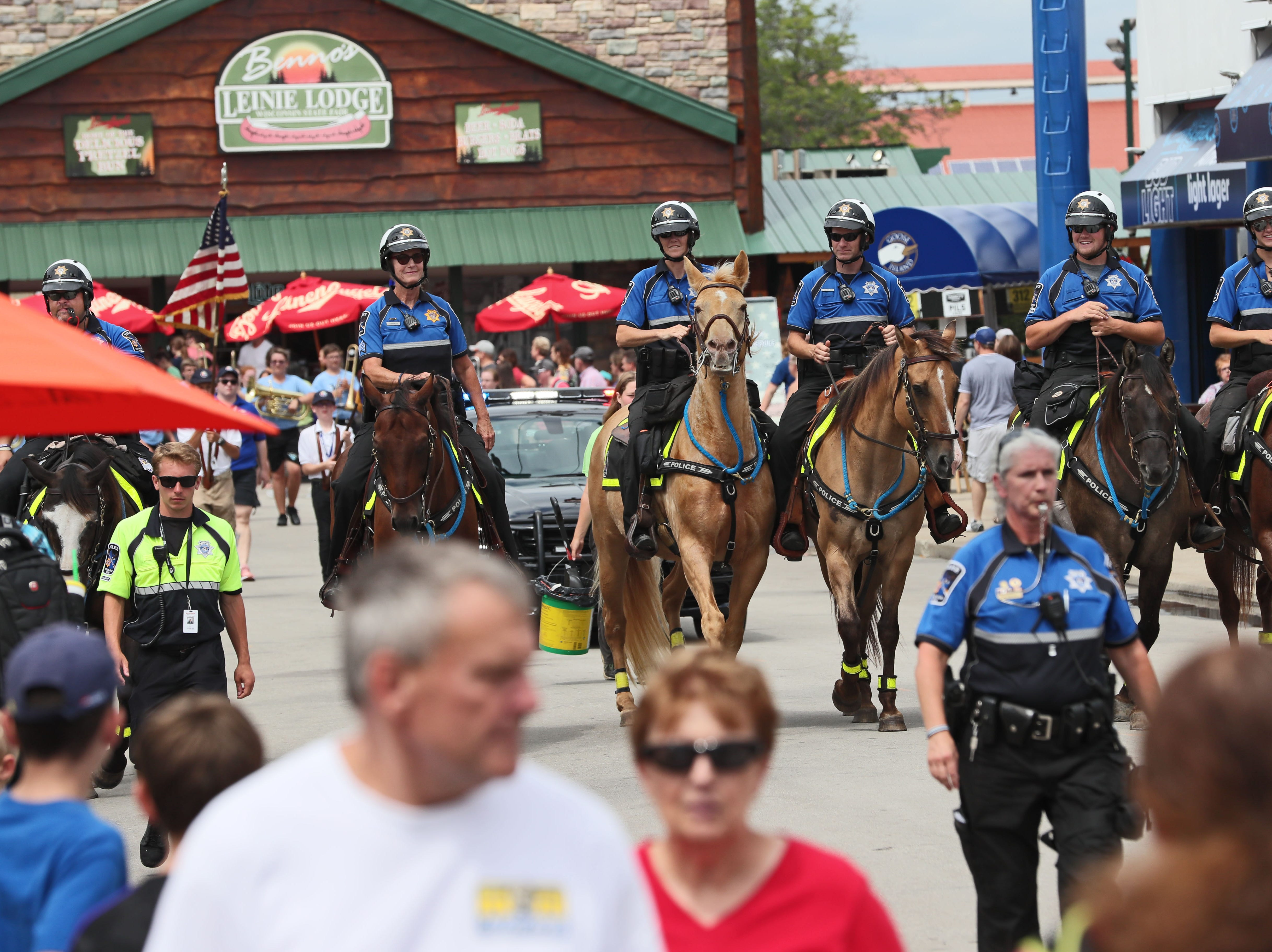 Wisconsin State Fair's mounted police patrol leads the daily parade. The mounted patrol is celebrating 50 years of service at the fair.