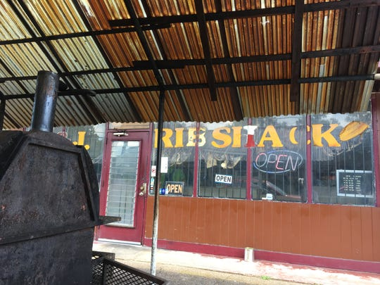 K&J Rib Shack cooks its food on a grill in front of the restaurant.