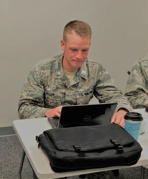 Cadet Eric Keller studies his course materials in preparation of his last assessment to ensure graduation from Total Force Officer Training at Maxwell AFB, Ala., July 18, 2018.