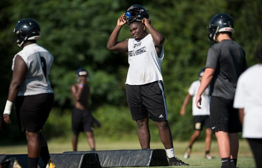 Defensive lineman Patrick Lucas takes a break in-between drills during practice at Wetumpka High School in Wetumpka, Ala., on Monday, Aug. 6, 2018.