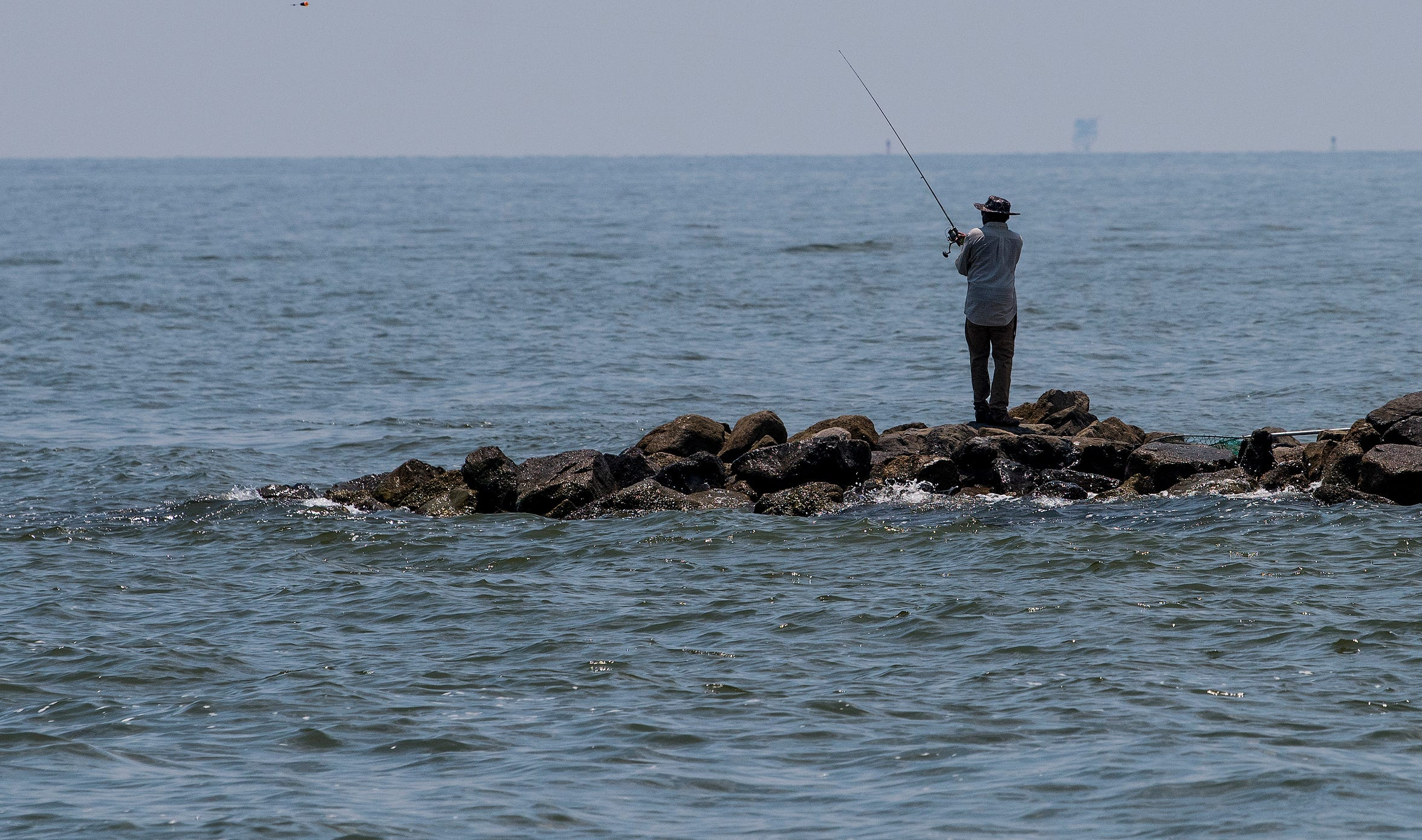 Fishing on Dauphin Island, Ala., on Tuesday July 26, 2018.
