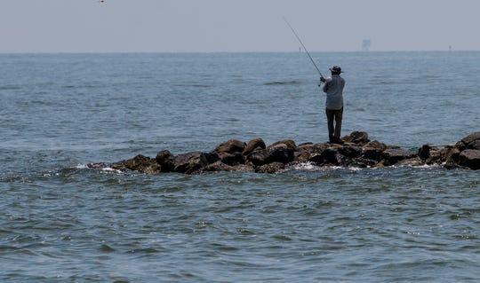 Fishing on Dauphin Island, Ala., on Tuesday July 26, 2018.
