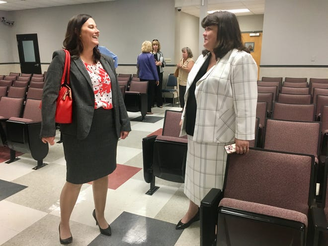 Stacey Edmonson, left, and Melanie Totty Cagle chat after the Trial Court Vacancy Commission meeting, during which the board voted to recommend both to Gov. Bill Haslam for possible appointment to the new judgeship in the 21st Judicial District.