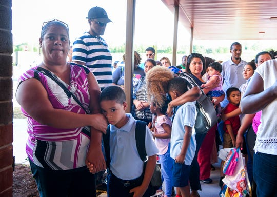 Parents wait at the front door with their children as the doors open on the first day of school at  Eagle View Elementary School in Antioch on Tuesday, Aug. 7, 2018.