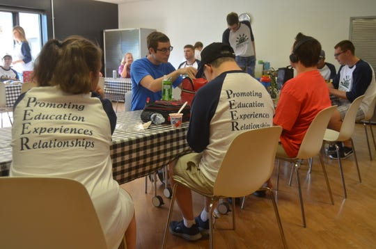 PEER Place students take a break for lunch at Indian Lake Peninsula Church.