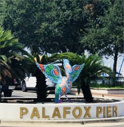 Colorful pelican welcomes visitors to the Palafox Pier in Pensacola.