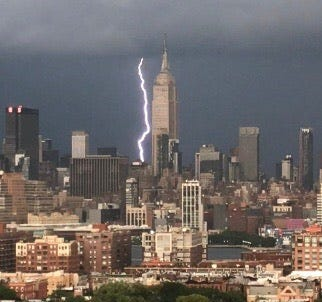 Lightning strikes behind the Empire State Building on Tuesday, Aug. 8. The storm set off emergency alert warnings throughout the tri-state area.