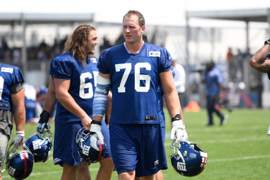 New York Giants tackle Nate Solder (76) walks off the field after NFL training camp in East Rutherford, NJ on Tuesday, August 7, 2018.