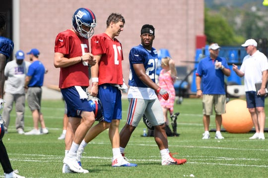 New York Giants quarterback Eli Manning (10) and rookie runningback Saquon Barkley (26) talk on the field during NFL training camp in East Rutherford, NJ on Tuesday, August 7, 2018.