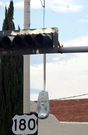 A semi tractor-trailer rig took out this light standard late Friday afternoon at the busy intersection of Pine and Gold streets in Deming. Traffic was rerouted during the home-from-work rush hour while New Mexico State Police and New Mexico Department of Transportation worked on safety issues regarding the dangling fixture.