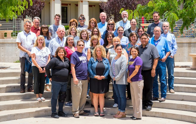 Participants in and instructors of Western New Mexico University's 25th annual basic rural economic development course group together on campus on the final day of the course, which ran July 22-26, 2018.