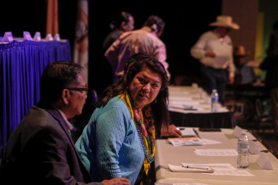Tom Tso and Hope MacDonald Lonetree talk before the start of a Navajo Nation presidential candidates forum Monday at the Phil L. Thomas Performing Arts Center in Shiprock.
