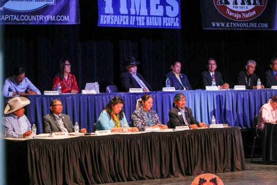 Navajo Nation presidential candidates prepare to take part in a forum Monday at the Phil L. Thomas Performing Arts Center in Shiprock.